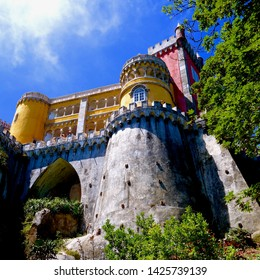 SINTRA, PORTUGAL - JULY 15, 2014: The sun shines on the Pena Palace on July 15, 2014 in Sintra, Portugal. Sintra is a popular resort town near Lisbon.