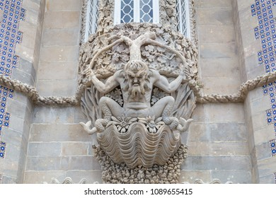 SINTRA, PORTUGAL - JUNE 14, 2016: Stone carved bas-relief of mythical triton with grape leaves on a wall of Pena National palace in Sintra near Lisbon, Portugal