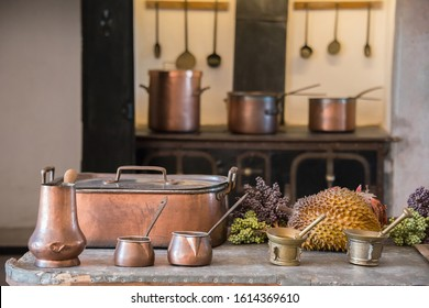 Sintra, Portugal - May 23, 2017: Ancient copper objects in the kitchens of the Pena National Palace with blurred background