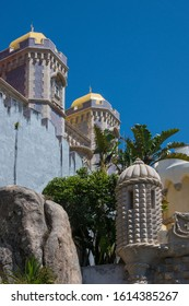 Sintra, Portugal - May 23, 2017: Towers and walls of Pena Palace, built on a rocky hill in the mountains near the district of Sao Pedro