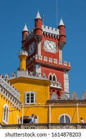 Sintra, Portugal - May 23, 2017: View of the walls and a colorful clock tower in Pena Palace built on a hill in the district of Sao Pedro