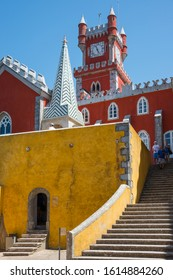 Sintra, Portugal - May 23, 2017: Stairs and interior walls overlooking the clock tower in the Pena Palace built on a hill in the district of Sao Pedro