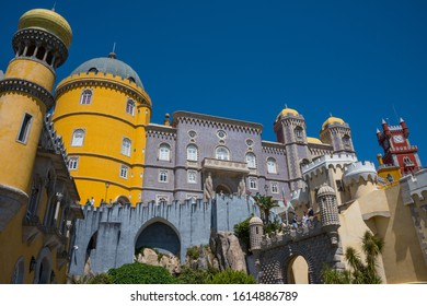 Sintra, Portugal - May 23, 2017: Perspective view of the colorful walls and exterior towers of Pena Palace built on a hill in the district of Sao Pedro