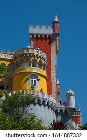 Sintra, Portugal - May 23, 2017: View of the exterior walls and towers of Pena Palace built on a hill in the district of Sao Pedro