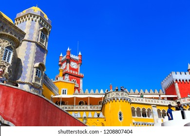 SINTRA, PORTUGAL - OCTOBER 12, 2018: Pena Palace, famous landmark. Summer morning landscape with blue sky in the Romanticist castle in São Pedro de Penaferrim, in the municipality of Sintra, Lisbon.
