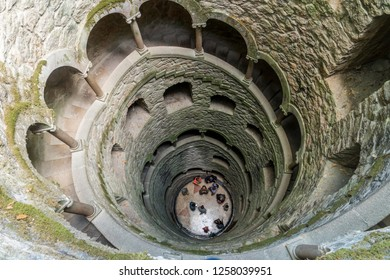 SINTRA, PORTUGAL,  october 25, 2017: People visiting The Initiation well of Quinta da Regaleira in Sintra, Portugal.