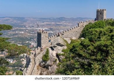 Sintra, Portugal, September 10, 2018: Tourists on Tower and wall of the medieval Castle  of the Moor Sintra Cultural Landscape,  UNESCO World Heritage Site