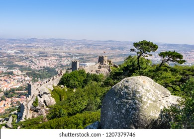 Sintra, Portugal, September 10, 2018: Tourists on Tower and wall of  the Castle  of the Moors on Portugal near Lisbon; Sintra Cultural Landscape,  UNESCO World Heritage Site