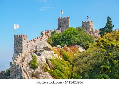 SINTRA, PORTUGAL - SEPTEMBER 6, 2017: Tourists visiting to Castle of the Moors (Castelo dos Mouros). View of the towers and stairways along the walls