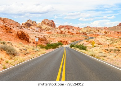 sinuous road crossing valley of fire desert, nevada