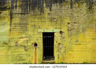 Sinz, Perl, Saarland, Germany - January 8, 2019: The wall around an entrance to a former World War Two Westwall bunker shows its battle scars
