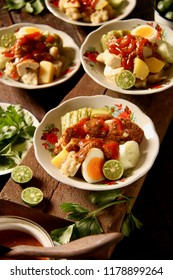 Siomay Bandung. Fish cake dumplings with potato, egg, and cabbage roll served with peanut and chili sauces.