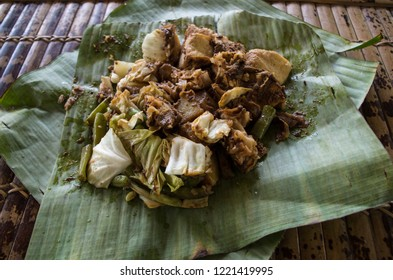 Siomay - Indonesian dish with steamed fish dumpling and vegetables served in peanut sauce in banana leaf.