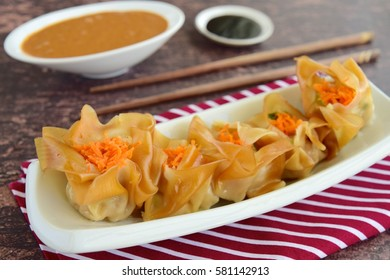 Siomay, Indonesian Food, steamed dumplings with peanut sauce and thick soy sauce or kecap manis