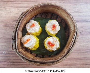 Siomay (Somay), an Indonesian steamed fish dumpling with vegetables served in peanut sauce. Top view close up details.