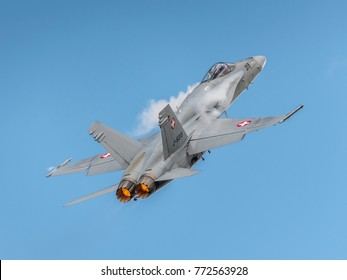 SION BREITLING AIR SHOW -  September 16, 2017. McDonnell Douglas F/A-18 Hornet J-5019. Military jet airplane of Swiss Air Force during exibition in the biggest Switzerland Airshow in a very blue sky.