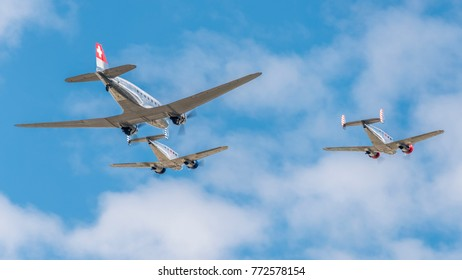 SION BREITLING AIRSHOW - September 16, 2017. Old and reflective Classic Formation, 2 Beechcraft Model 18s and 1 Douglas DC-3 Frossair during exibition over Sion Airport, Switzerland. Swiss Airshow