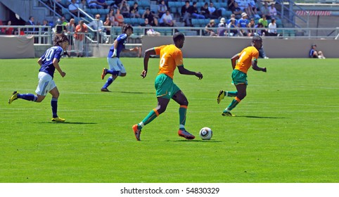 SION, SWITZERLAND - JUNE 4: Soulemane Samba runs with the ball for the Ivory Coast in a friendly match against Japan for the 2010 world cup:  June 4, 2010 in Sion Switzerland