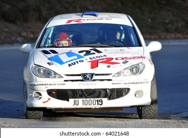 SION, SWITZERLAND - OCTOBER 28: Dubuis (driver) and Lugon on Day 1, Stage 1 of the International Rally of the Valais in their Peugeot 206 kit: October 28, 2010 in Sion Switzerland