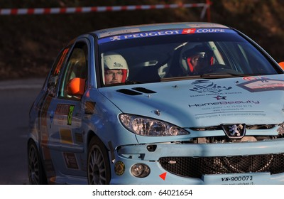SION, SWITZERLAND - OCTOBER 28: Eggmann (driver) and Pittet on Day 1, Stage 1 of the International Rally of the Valais in their Peugeot 206: October 28, 2010 in Sion Switzerland