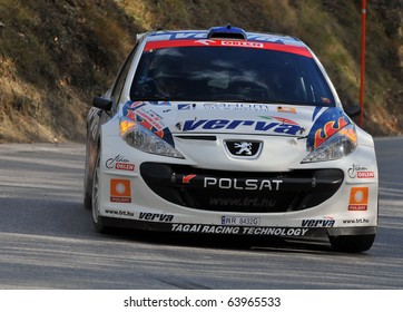 SION, SWITZERLAND - OCTOBER 28: Polish Orlen team on on Day 1, Stage 1 of the International Rally of the Valais in a Peugeot 207: October 28, 2010 in Sion Switzerland