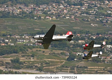 SION, SWITZERLAND - SEPTEMBER 15: DC-3 and Beechcraft 18 in the Breitling Air Show:  September  15, 2017 in Sion, Switzerland