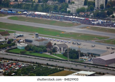 SION, SWITZERLAND - SEPTEMBER 17:  Aerial view of airodrome, planes  and spectators at the Breitling Air show.  September 17, 2011 in Sion, Switzerland