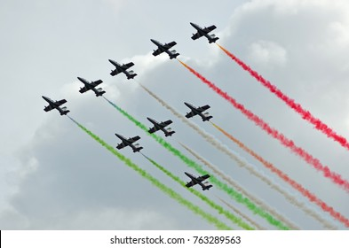 SION, SWITZERLAND - SEPTEMBER 17: Frecce Tricolori trailing smoke in the Breitling Air Show:  September  17, 2017 in Sion, Switzerland