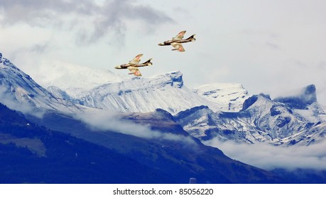 SION, SWITZERLAND - SEPTEMBER 18:  Hawker Hunter display in the mountains at the Breitling Air show.  September 18, 2011 in Sion, Switzerland