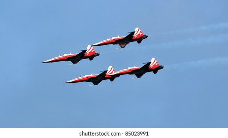 SION, SWITZERLAND - SEPTEMBER 18: Swiss Air Force team in formation in a blue sky at the Breitling Air show.  September 18, 2011 in Sion, Switzerland