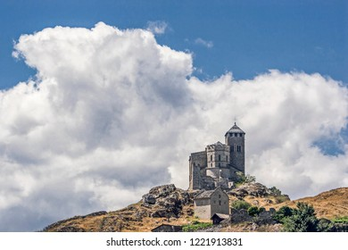 Sion is a town in the Rhone Valley and the capital of the canton of Valais at the mouth of the Sionne in the Rhone.