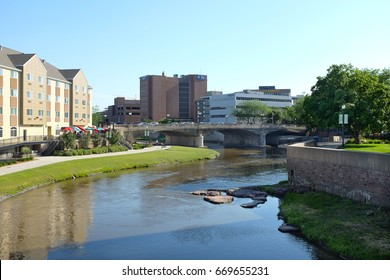 SIOUX FALLS, SOUTH DAKOTA - JUNE 21, 2017: Riverwalk along the Big Sioux River. Parks, hotels, restaurants and footbridges, line the popular area along the cities revitalized downtown district.