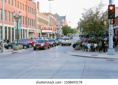 Sioux Falls, South Dakota, United States - September 8, 2017: Downtown entertainment district, with people enjoying fall weather outdoors.