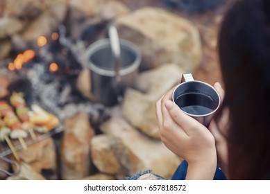 Sip coffee in a glass, grill and barbecue. Romantic atmosphere. Relaxing time camping on a mountain. Activity in holiday concept.