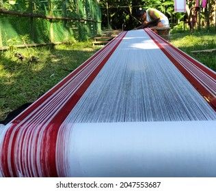 Sipajhar, Assam, India, September 26,2021: Traditional handloom craft from Assam being prepared for weaving in daylight against natural environment ahead of annual harvest festival