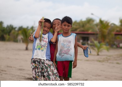 SIPALAY, PHILIPPINES - June 22, 2014: Filipino kids having fun on the beach, Sugar beach, Sipalay, Philippines