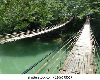 The Sipatan twin bamboo hanging bridge across Lobic river at Bohol island, Philippines.
