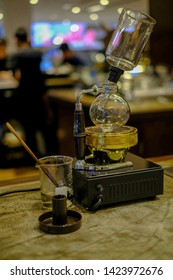 Siphon classic coffee maker on counter at coffee shop.