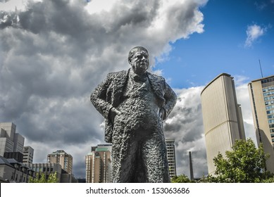 Sir Winston Churchill Memorial in Toronto, Canada with dramatic sky behind symbolic of coming out of dark times into blue skies..