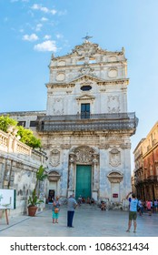 Siracusa, Italy - August 17, 2017: Facade of the church of Santa Lucia Alla Badia in the Piazza Duomo with people around in the old town of the historic village of Siracusa in Sicily, Italy