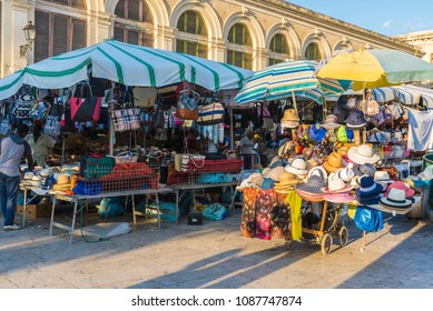 Siracusa, Italy - August 17, 2017: Vendor in a souvenir shop with objects of all kinds highlighting panama hat in a flea market in the old town of the historic city of Siracusa in Sicily, Italy
