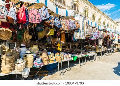 Siracusa, Italy - August 17, 2017: Souvenir shop with objects of all kinds highlighting panama hat in a flea market in the old town of the historic city of Siracusa in Sicily, Italy