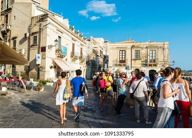 Siracusa, Italy - August 17, 2017: Street with people around in the old town of the historic city of Siracusa in Sicily, Italy
