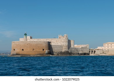 Siracusa, Italy - March 27 2017 - the Maniace Castle (build by Frederick II ), in Ortygia, seen from the sea