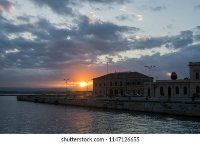 Siracusa, Italy: October 30 2017: view from the port of Siracusa to a house and a beatiful sunset over the sea