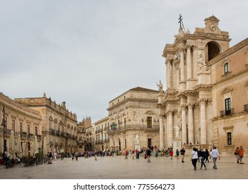 "SIRACUSA, ITALY - SEPTEMBER 26, 2017: Tourists visiting the famous baroque square ""Piazza del Duomo"" in Siracusa old town on Ortigia Island"