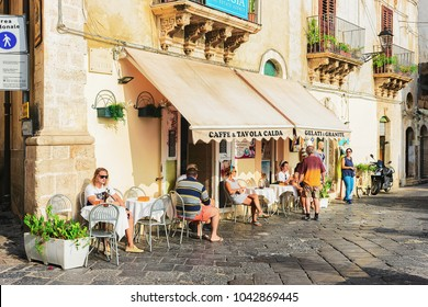 Siracusa, Italy - September 28, 2017: People at cozy street cafe in Siracusa, Sicily, Italy