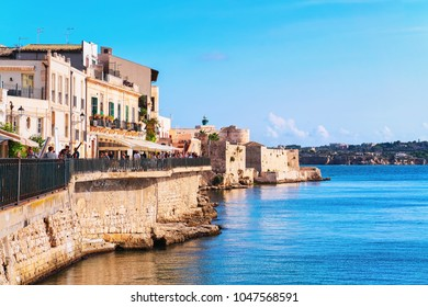 Siracusa, Italy - September 28, 2017: Embankment in the old city in Siracusa and the Mediterranean sea, Sicily, Italy