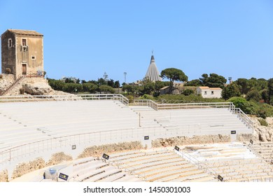 Siracusa, Sicily, Italy - May 01, 2019: Panoramic view of Teatro Greco, Greek amphitheater in Siracusa, Sicily, spectator seats, Spring sunny day