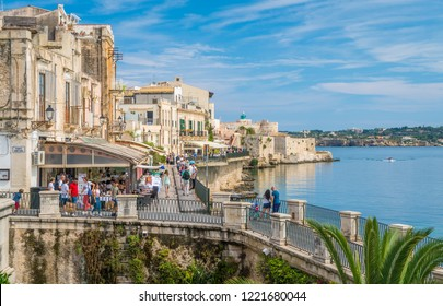 Siracusa waterfront in Ortigia with the castle in background, on a sunny summer day. Sicily, southern Italy. July-15-2018